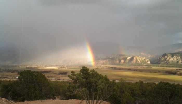 Overcast with double rainbow over Kanarraville from across the valley