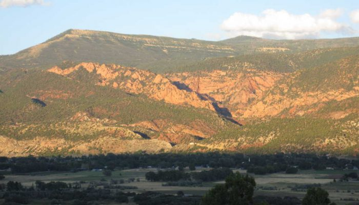Spring Creek Canyon at sunset from across the valley
