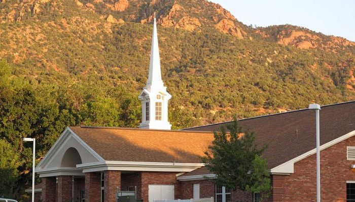 Kanarraville LDS Church with white steeple against mountain backdrop